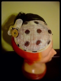 Polka dot sinamay fascinator with feathers & oversized mother-of-pearl button